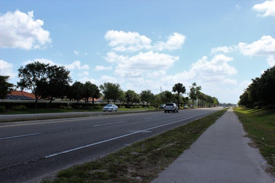 Cars drive on Estero Parkway in Estero in May 2018.