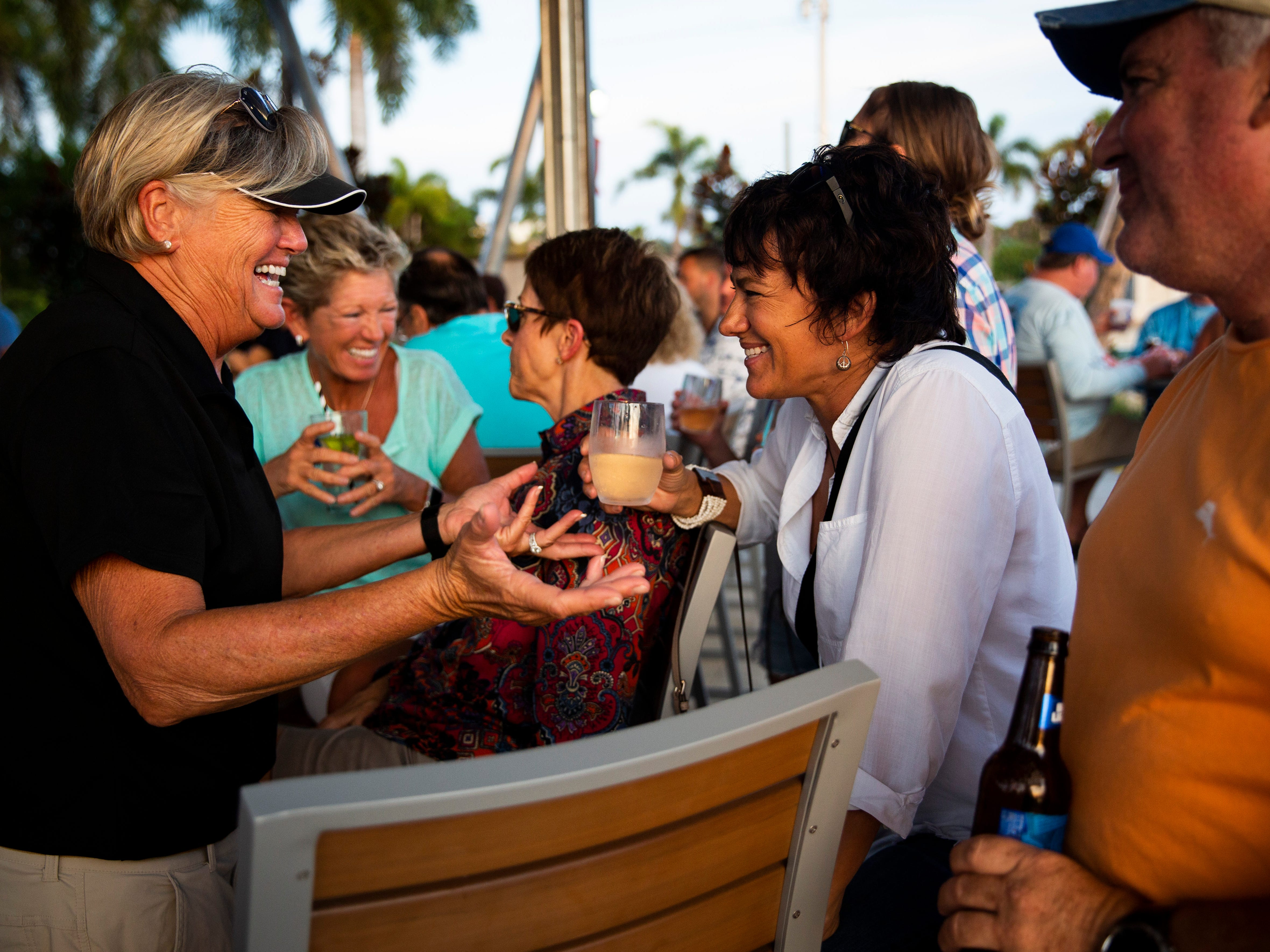 Robin Forbes, left, and Cheri Burton, right, laugh as they drink at the bar on Sunday, Nov. 25, 2018, at Celebration Park in the Bayshore area of East Naples.