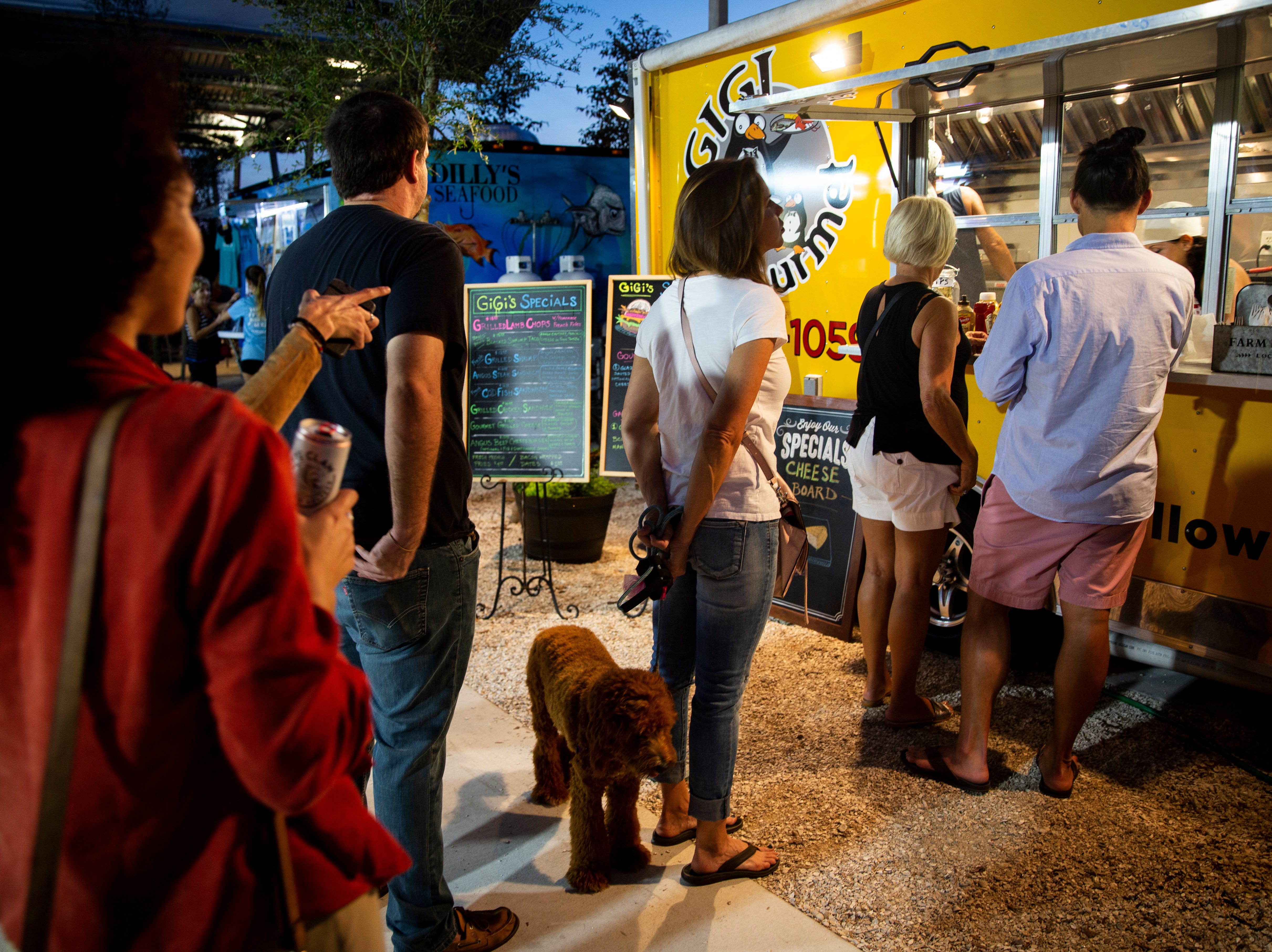 Customers wait in line to order food from Gigi Gourmet on Sunday, Nov. 25, 2018, at Celebration Park in the Bayshore area of East Naples.