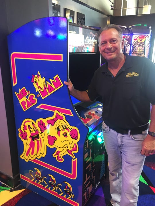 Bob Schuster with Ms. Pac Man at the Saturn 5 arcade at Coastland Center.