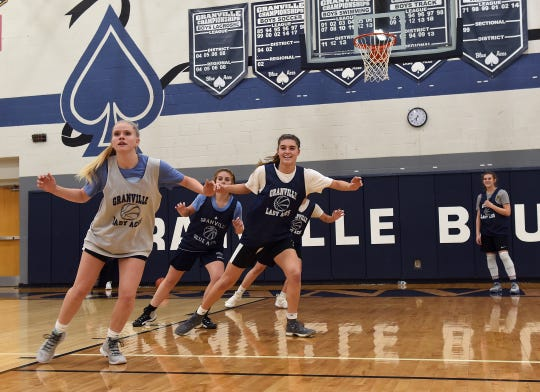 Granville basketball players Molly Wilson, Chloe Mulford and Lauren Newkirk run a defensive drill during a practice on Monday, Nov. 19, 2018 at the high school.