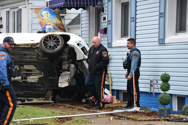 A car crashed into the steps of a Fair Lawn home on Monday, injuring the driver and passenger.