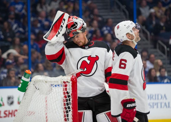 New Jersey Devils goaltender Cory Schneider (35) reacts after giving up a goal during the second period of the team's NHL hockey game against the Tampa Bay Lightning, Sunday, Nov. 25, 2018, in Tampa, Fla.