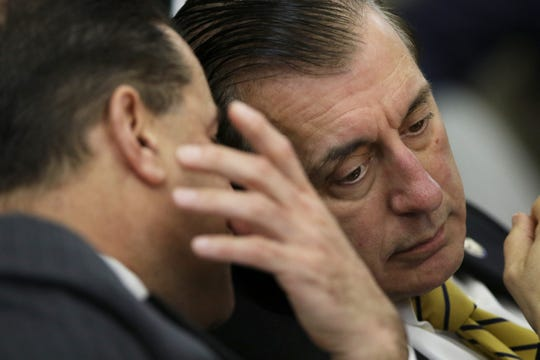 Assemblyman John Burzichelli listens to Sen. Paul Sarlo in 2018.