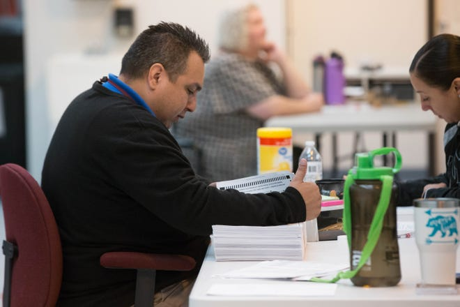 Employees from the Doña Ana County Clerk's office participate in a statewide voting system check of electronic vote tabulators Monday, Nov. 26, 2018, at the Bureau of Elections Warehouse. The check takes place after all general elections.
