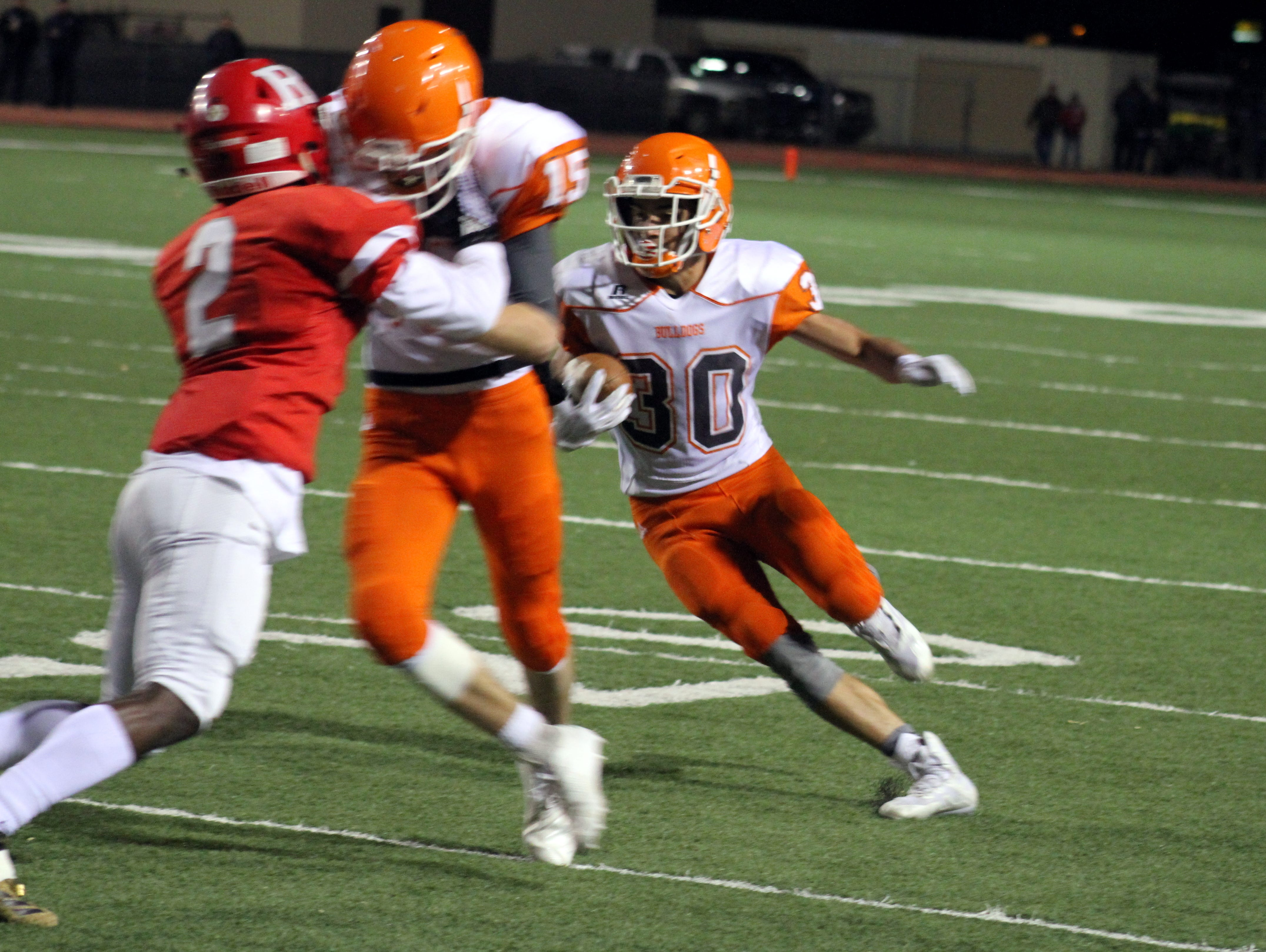 Artesia's Jagger Donaghe gets a block by AJ Estrada (15) during Friday's Class 5A semifinal game.