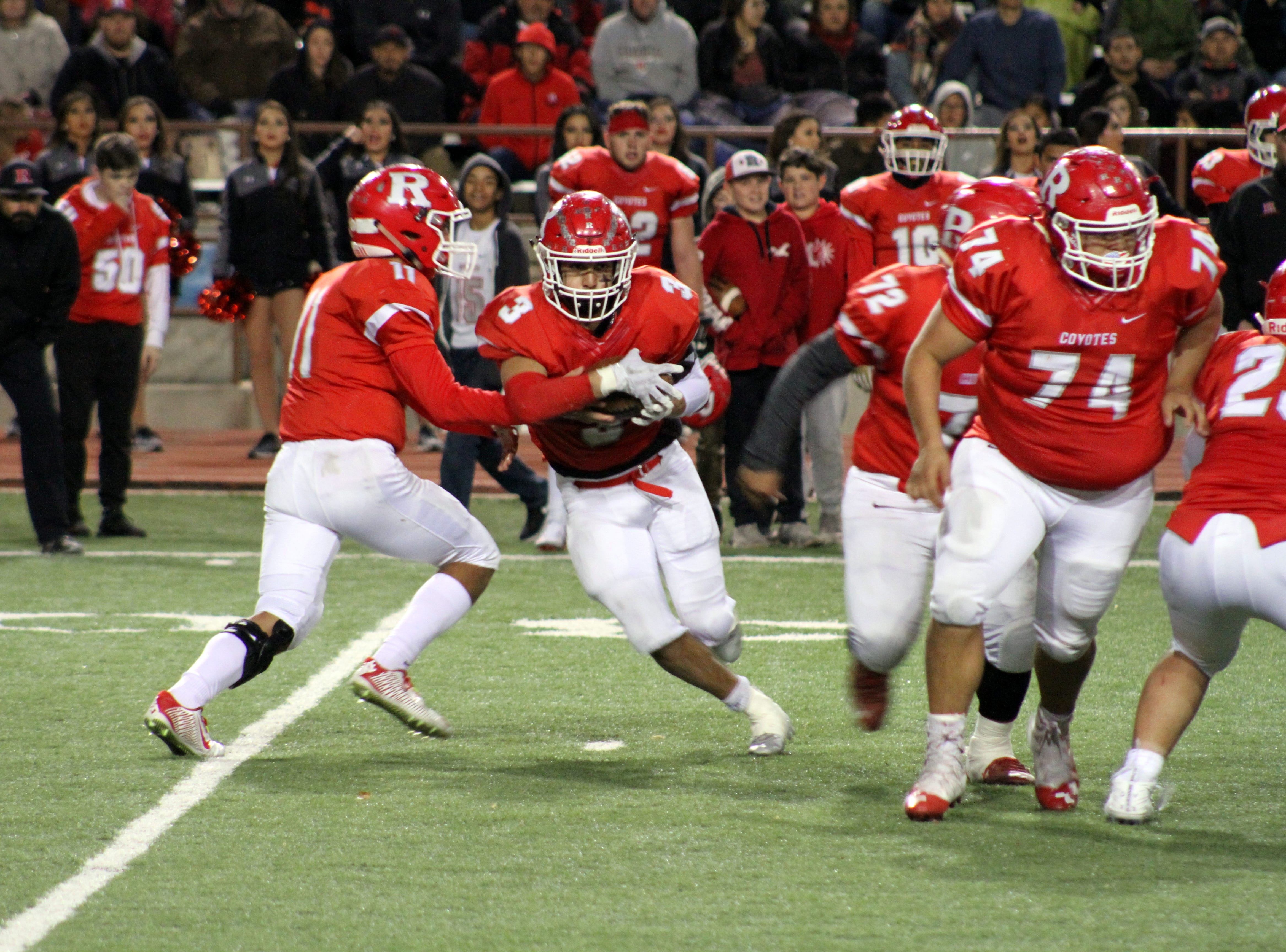 Roswell's Justin Carrasco takes a handoff during Friday's Class 5A semifinal game against Artesia. He finished with 23 carries for 140 yards and two touchdowns.