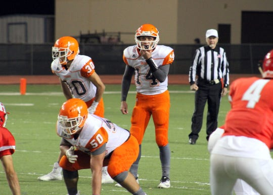 Artesia quarterback Trent Taylor calls an audible during Friday's Class 5A semifinal game.
