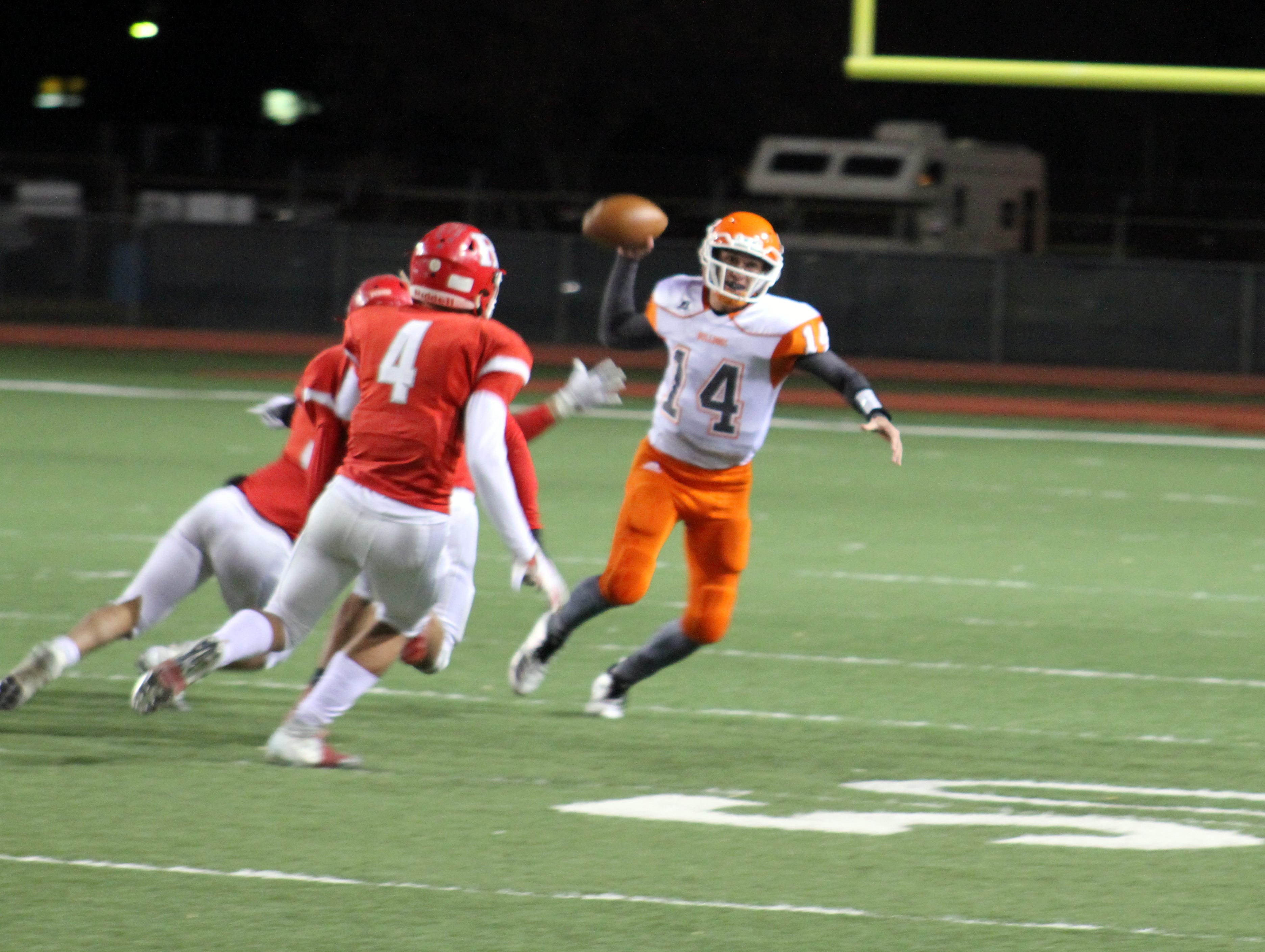 Artesia's Trent Taylor escapes a sack attempt during Friday's Class 5A semifinal game. Taylor finished with 338 passing yards, four touchdowns and one interception.