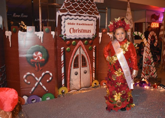 Vizcaya Borunda, 5, poses after winning Most Christmas Spirit during the Little Miss and Mr. Christmas Pageant last year.
