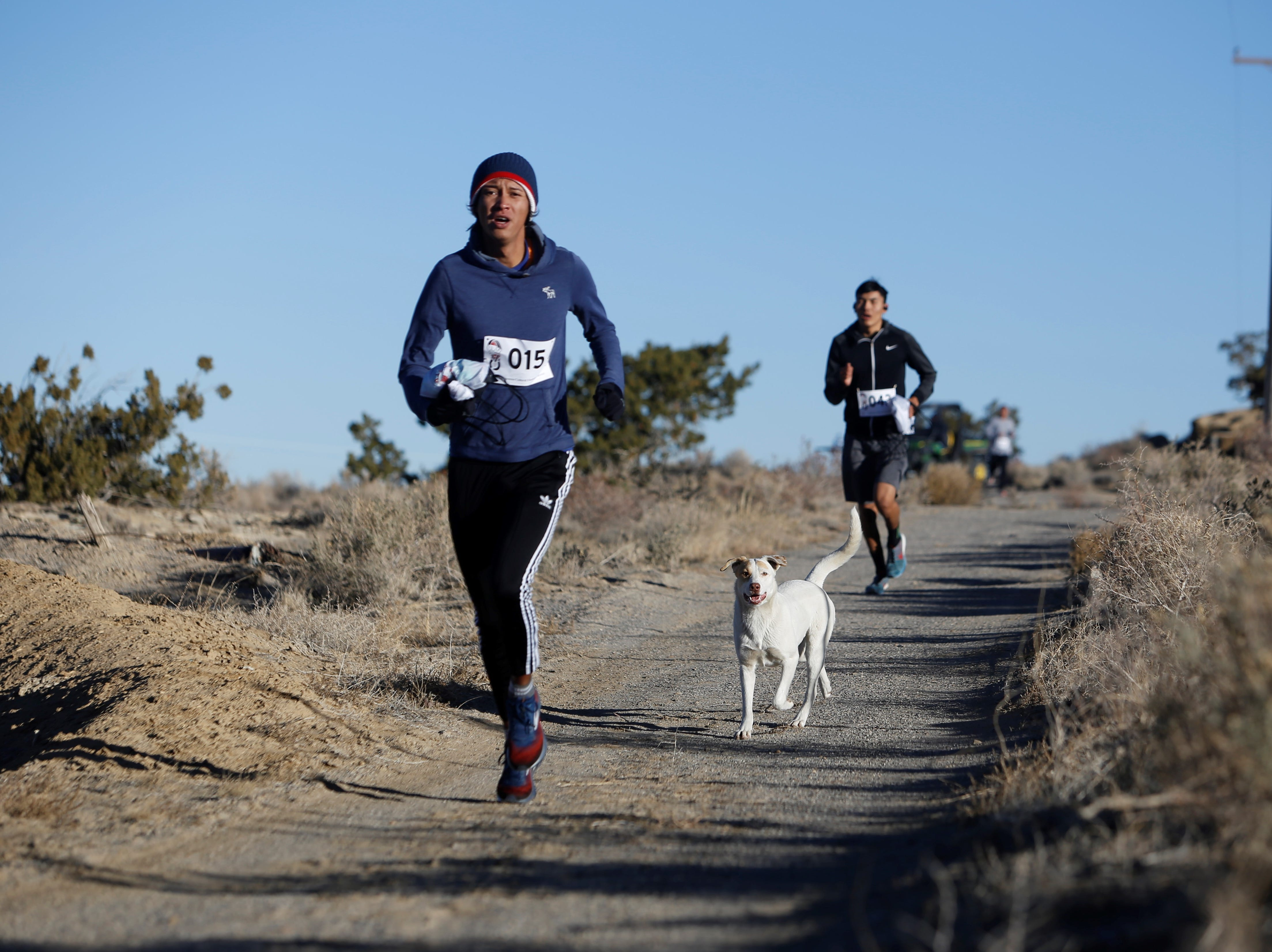 Runners complete the course for the Clan Run on Monday at Navajo Technical University in Crownpoint.