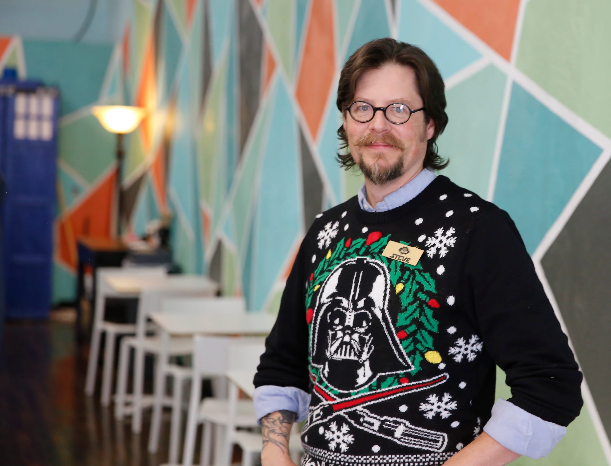 Tales of Tomorrow co-owner Steve Clark sported his light-up holiday sweater on the first day of the business' long-awaited Cosmic Cafe, which had a soft opening with coffee and baked goods on the retail store's first anniversary during the Small Business Saturday event in downtown Farmington. The cafe will be open on Saturdays for now featuring baked goods created by co-owner Lauren Harris.
