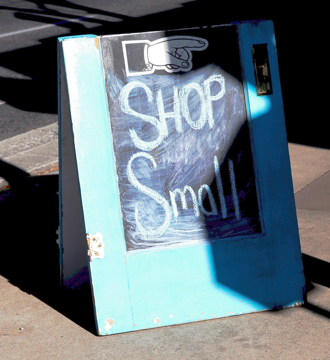 """A sign urging shoppers to """"Shop Small"""" was one of many on Main Street downtown during the Small Business Saturday event that took place Nov. 24."""