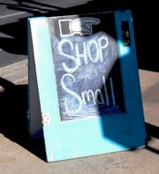 "A sign urging shoppers to ""Shop Small"" was one of many on Main Street downtown during the Small Business Saturday event that took place Nov. 24, 2018 in Farmington. Small businesses may face big impacts when the state's minimum wage increases in January 2020."