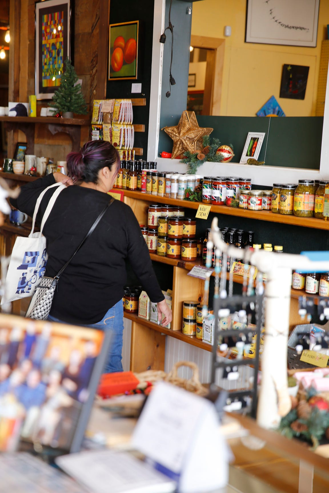 A shopper browses the specialty food display inside Artifacts Gallery during the Small Business Saturday event in Downtown Farmington this weekend.