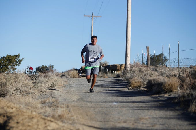 Perry R. James, assistant professor for Navajo Studies, helped organize the Clan Run for students, staff and community members at Navajo Technical University in Crownpoint.