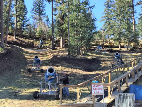 A worker at Ruidoso Winter Park prepares a snow making machine prior to opening day for the 2018-2019 season.