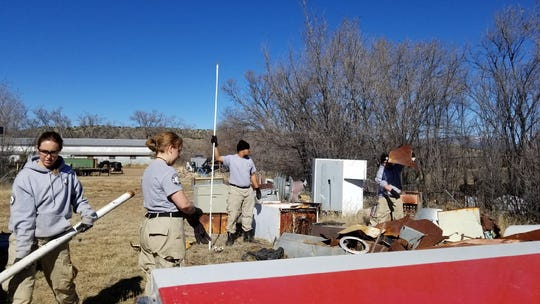 Members of the Americorps team at Fort Stanton stay busy with projects.