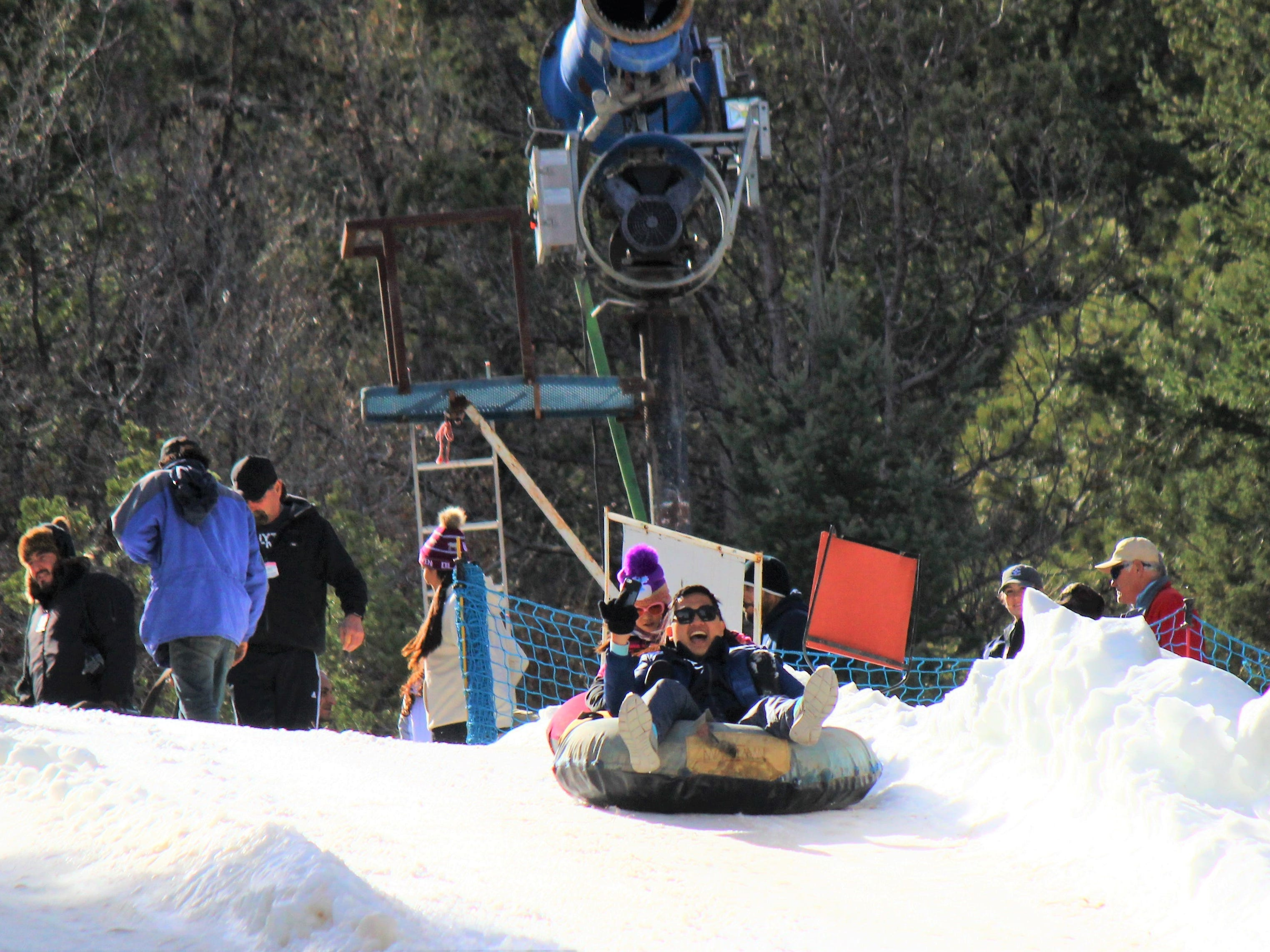 From the beginning to the end of a run, these adventure seekers at Ruidoso Winter Park are enjoying their tubing ride downhill.