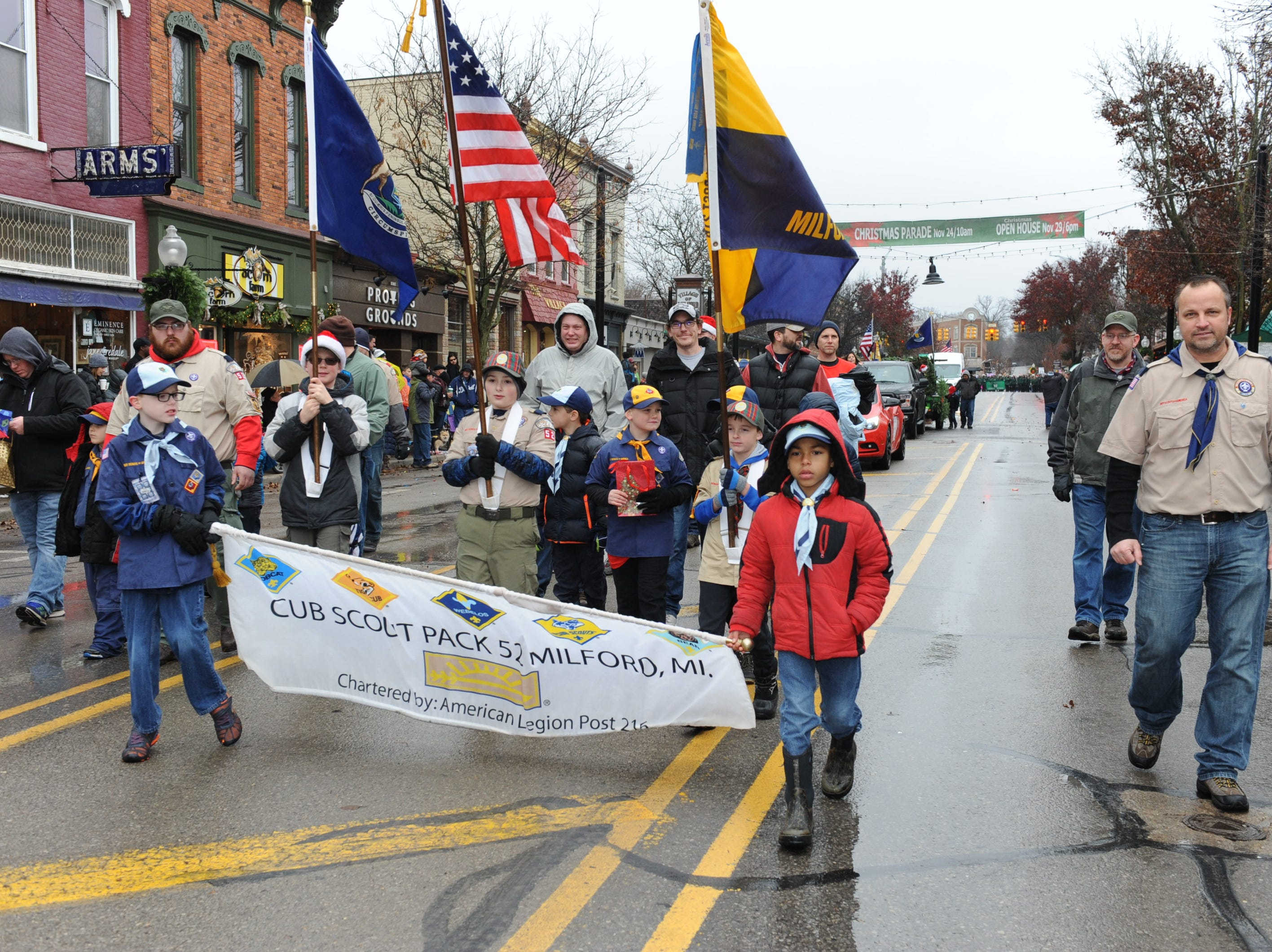 Milford Cub Scout Pack #52 marches in the annual parade in Milford.
