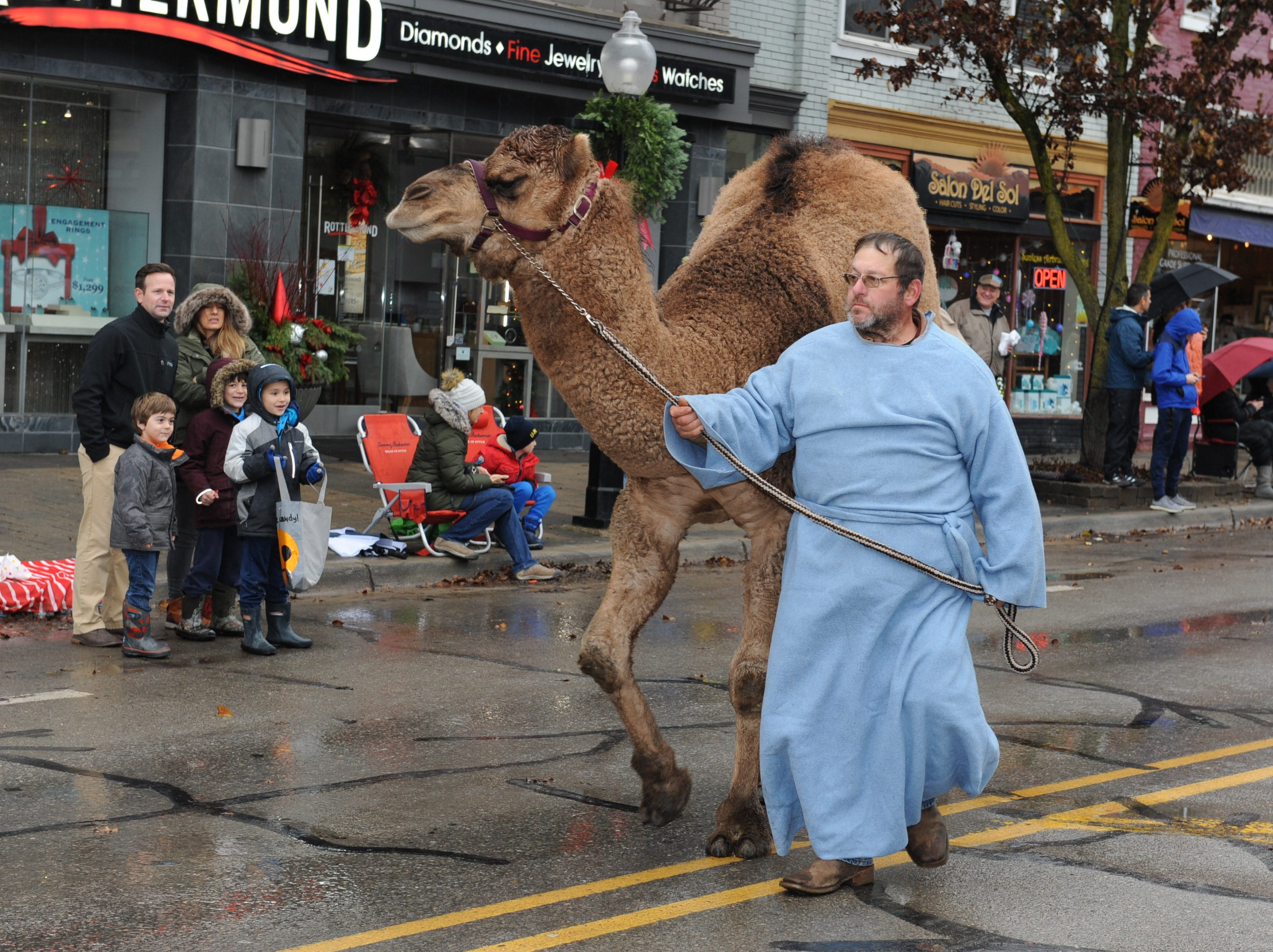 A Christ Lutheran Church member shows off his camel during the annual Milford Christmas parade.