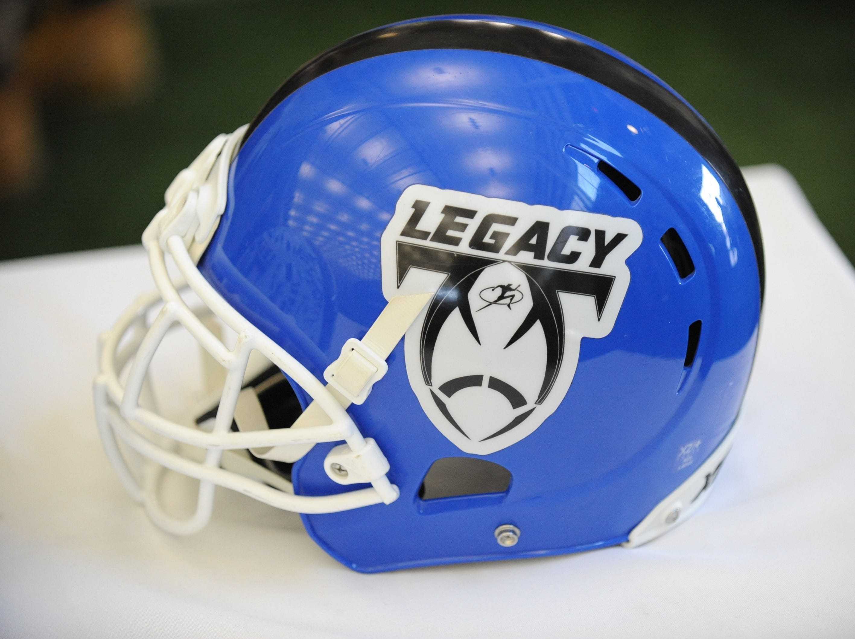One of the Legacy football program's helmets is displayed.