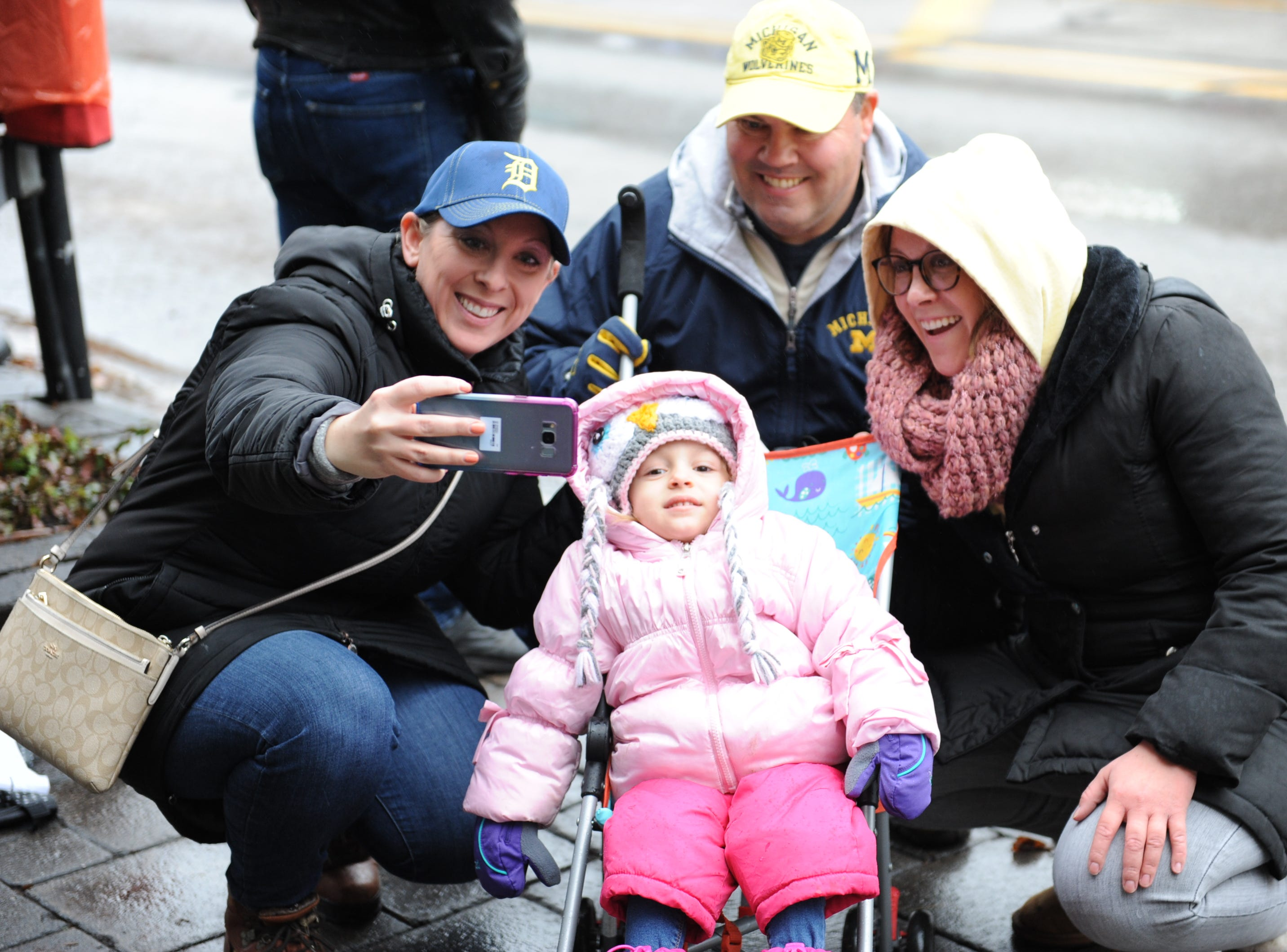 The Rosins and Shorez family take a selfie at the Milford Christmas Parade Saturday.