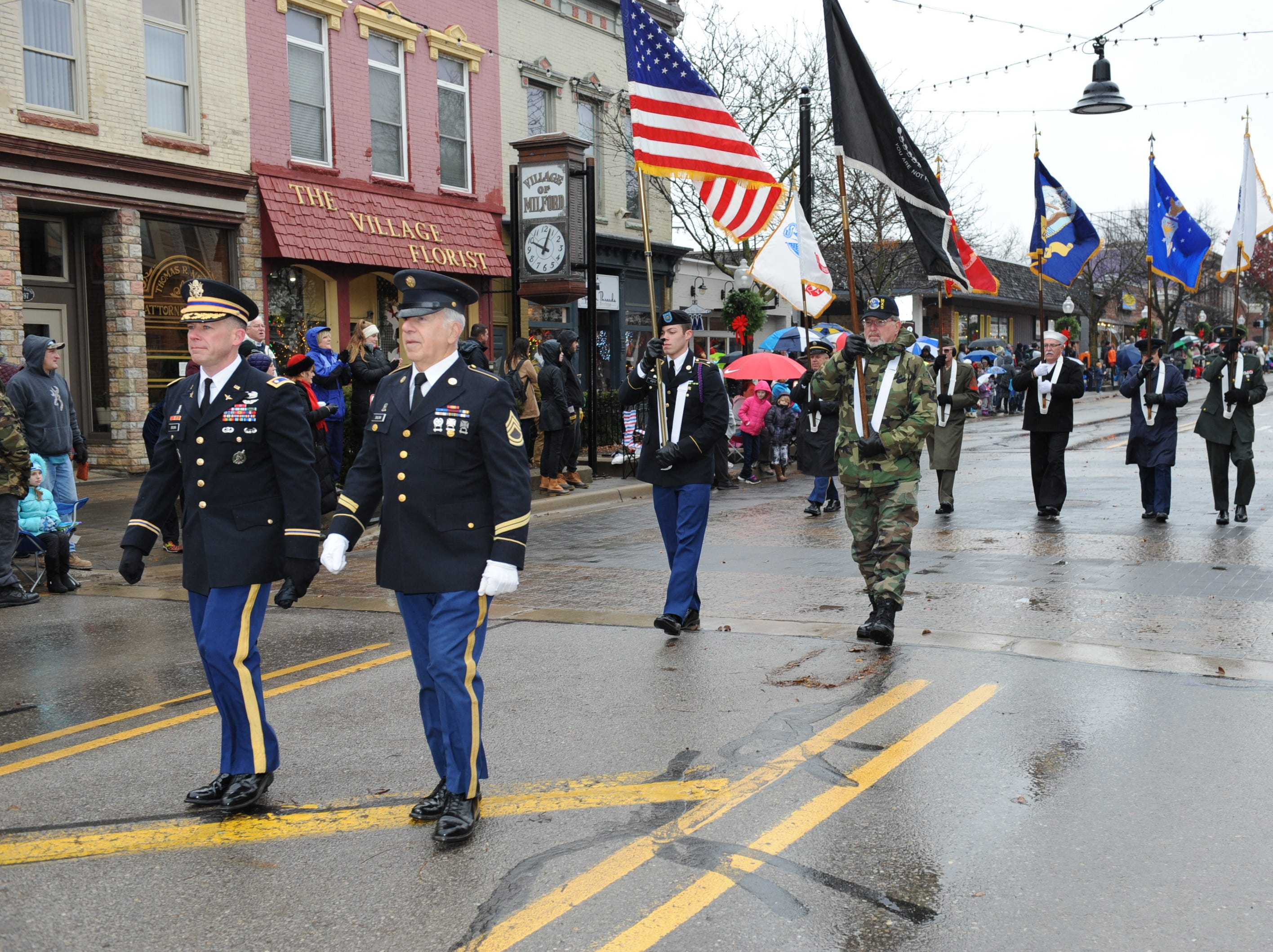The Military Honor Guard kicks off this year's Milford Christmas parade.