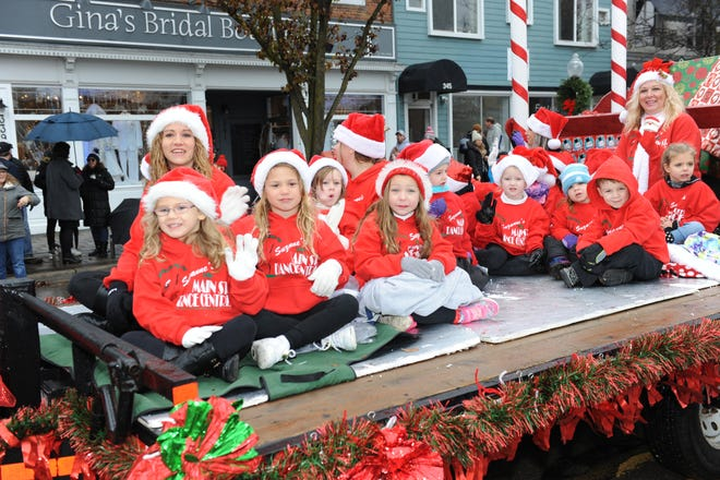 Little ones from the Main Street Dance Centre wave to the crowds Saturday morning.