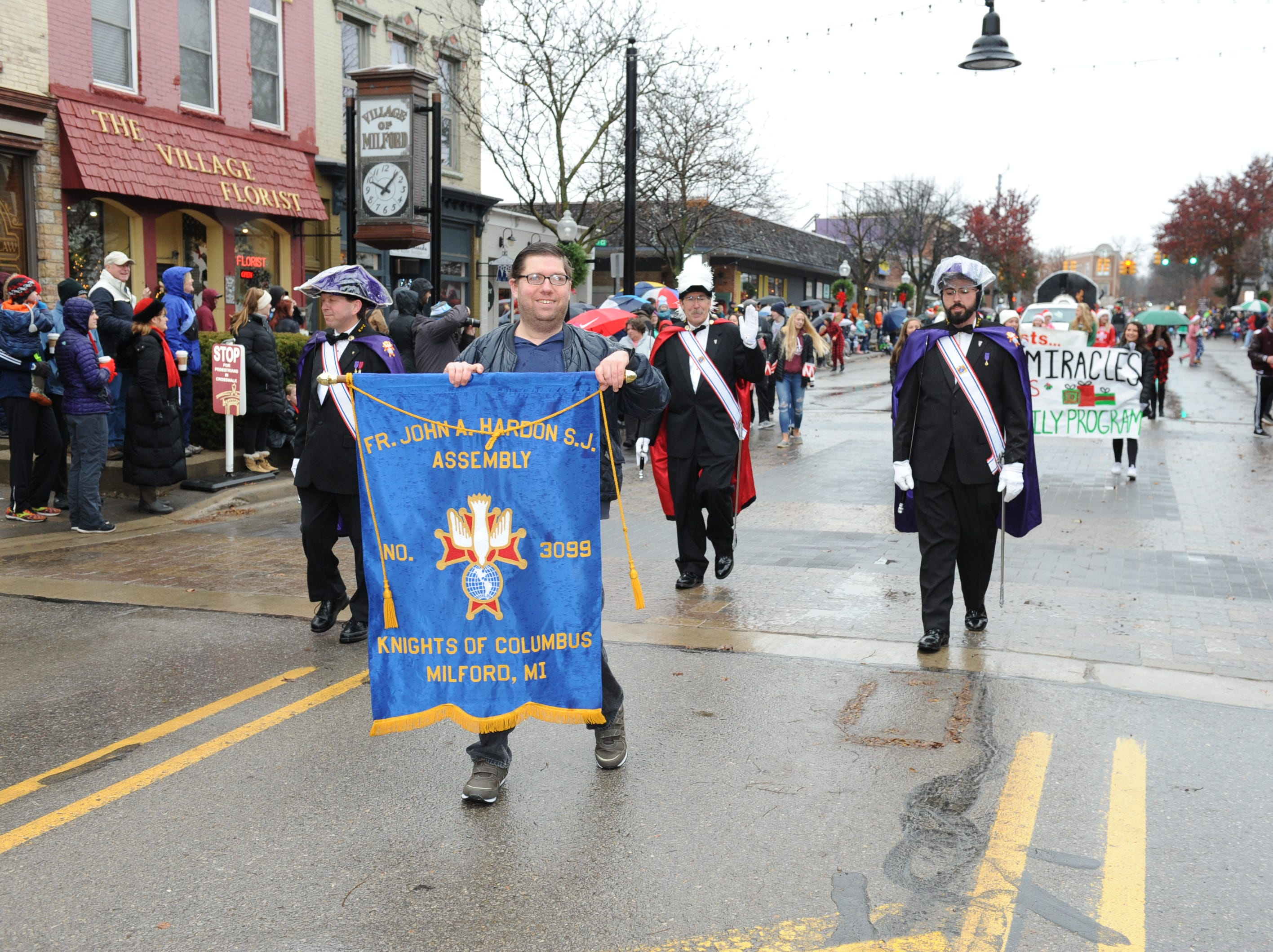 The Knights of Columbus 4th Degree Honor Guard takes part in the annual Milford Christmas parade.