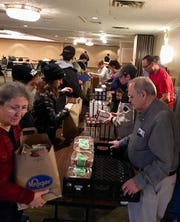 Parishoners at Sts. Constantine and Helen Greek Orthodox Church pack Thanksgiving meals for area needy families.