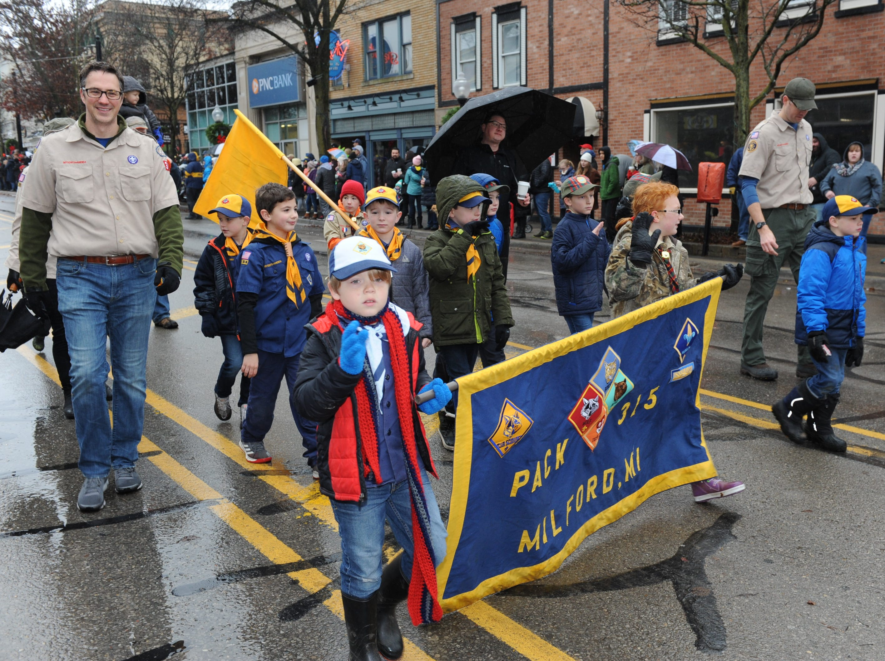 Milford Cub Scout Pack #315 waves to the crowds in downtown Milford.