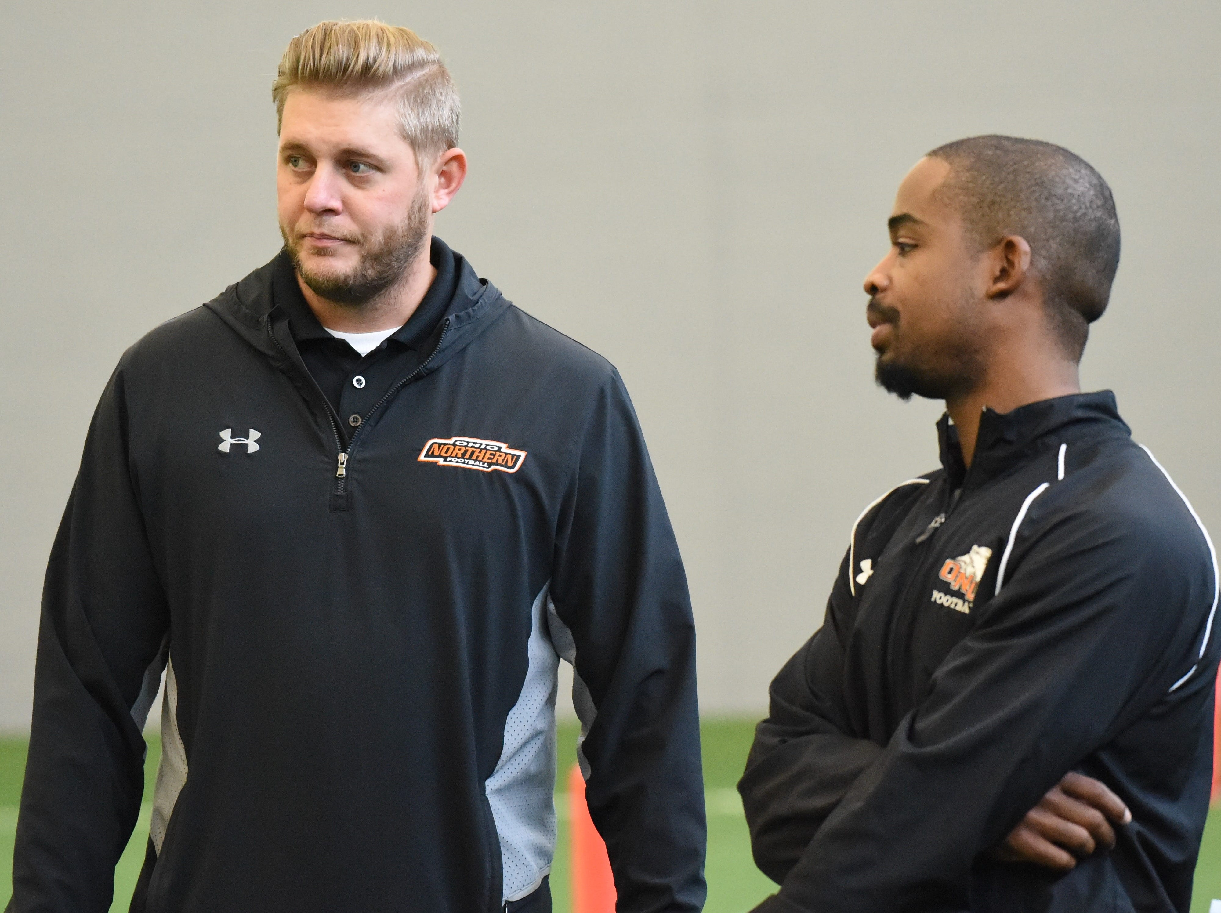 A number of coaches and scouts from colleges watched Sunday's game at Legacy Center, including Northern Ohio University's Sean Buckley (left) and Dru Richardson.
