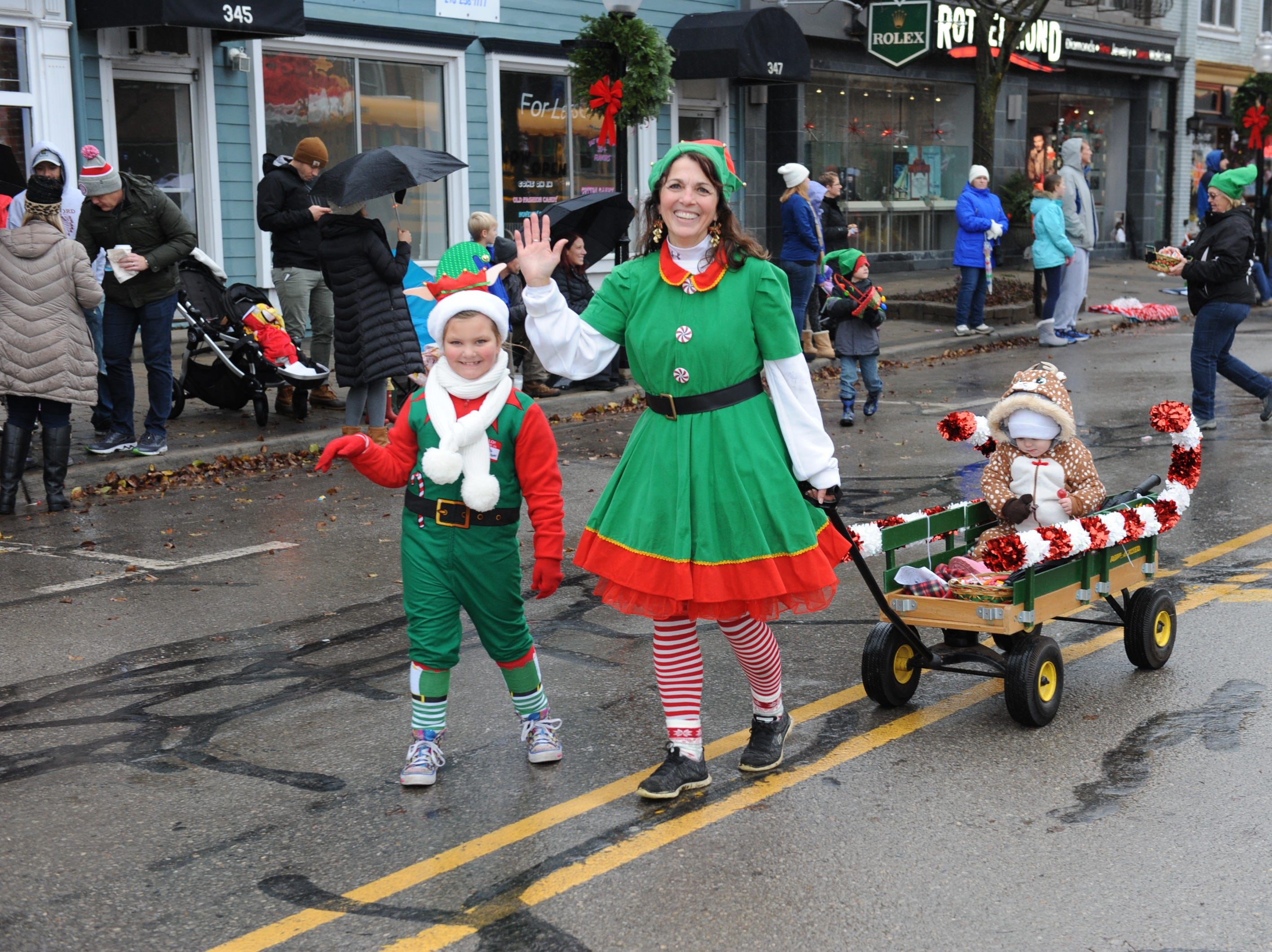 The streets of Milford find elves and their helpers during the annual Christmas parade.