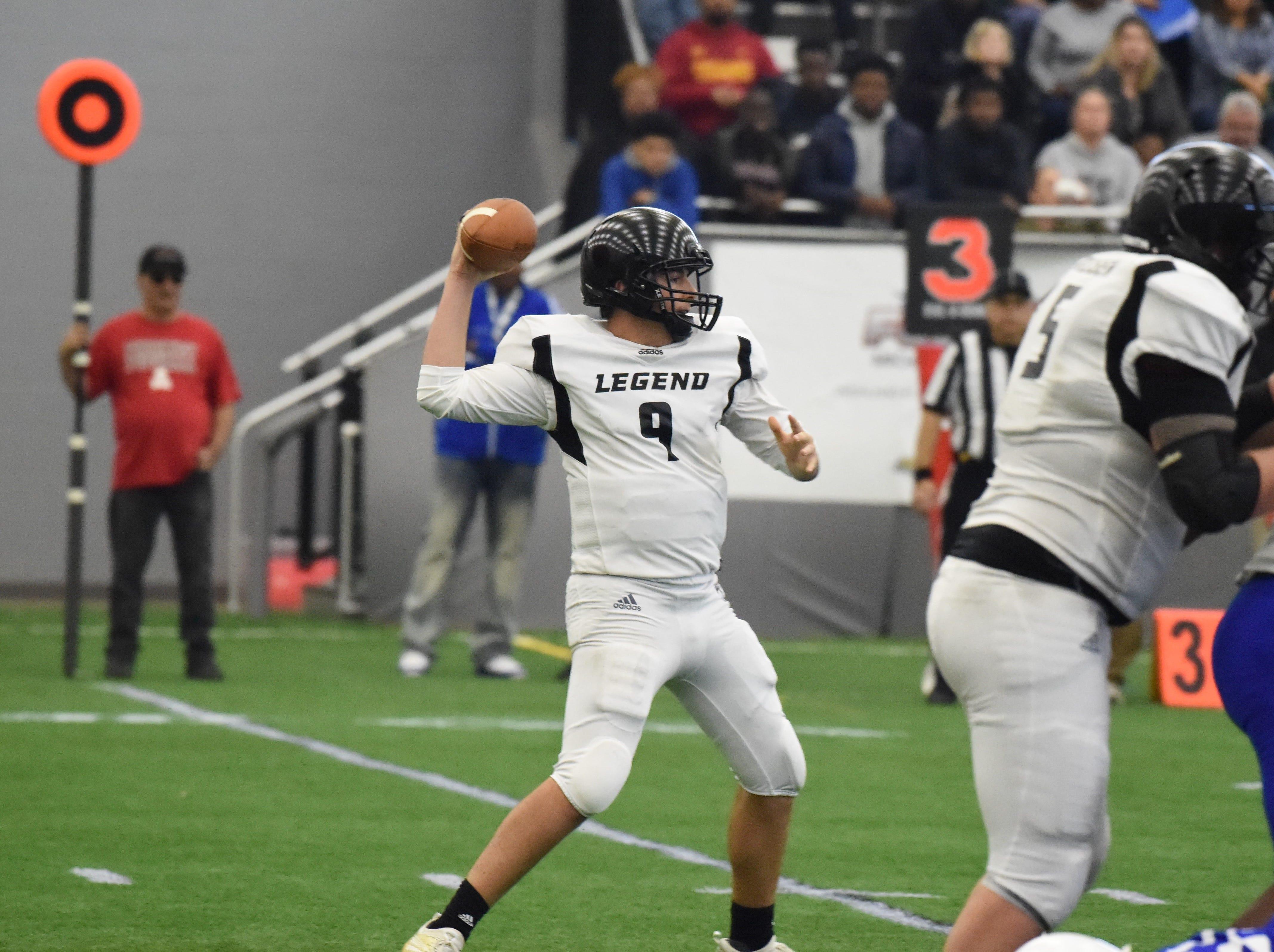 Ready to throw the football is Team Legends quarterback Matt Hornyak (9).