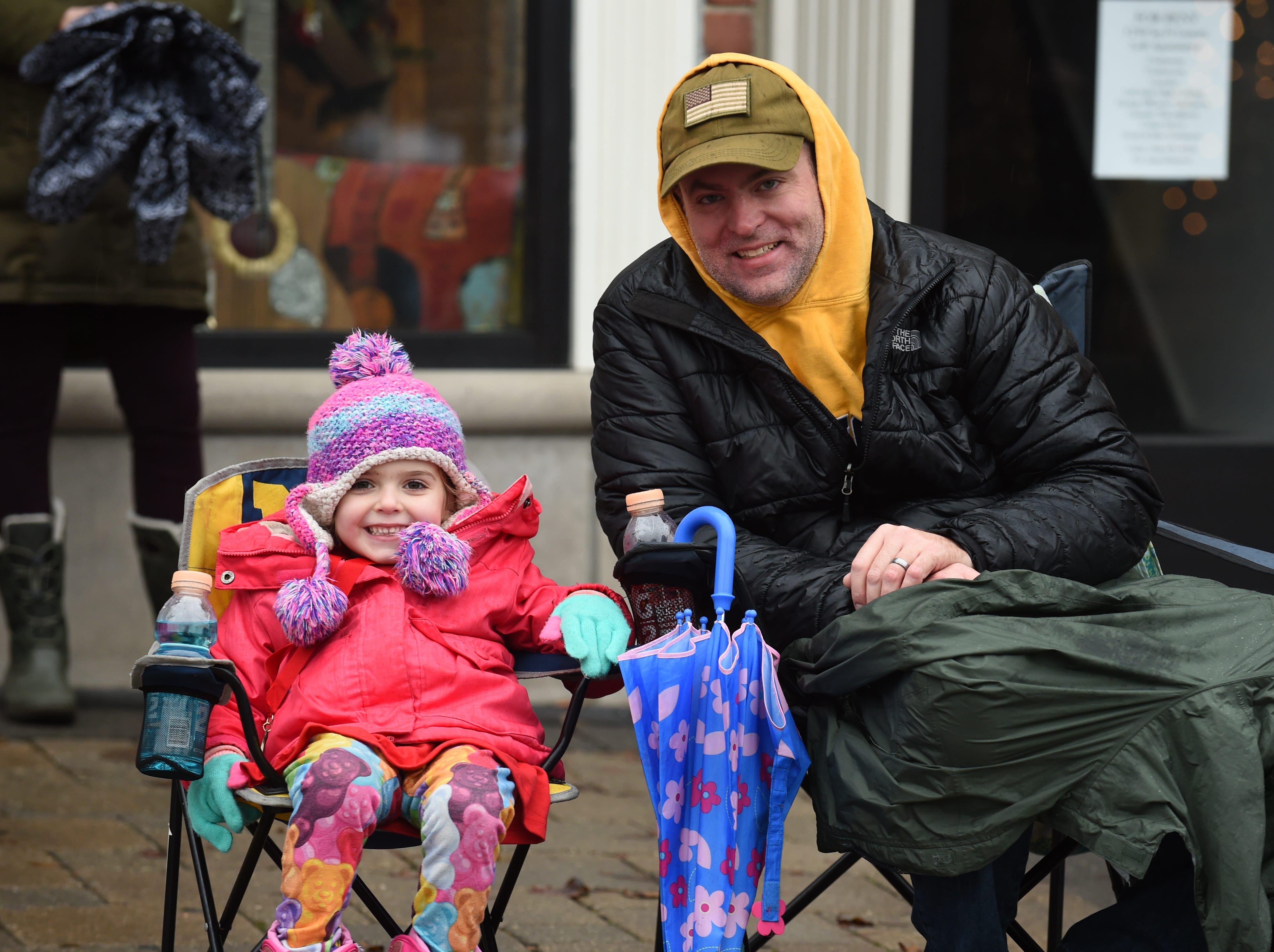 Adeline and Jay Laws of Milford wait for the annual parade in Milford Saturday.