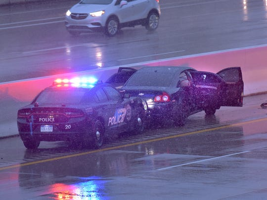 The suspect's vehicle rests Against the-median barrier on westbound I-96 just west of Levan Road. A POSSIBLE Seen bullet hole in the window of the-the-rear passenger door.