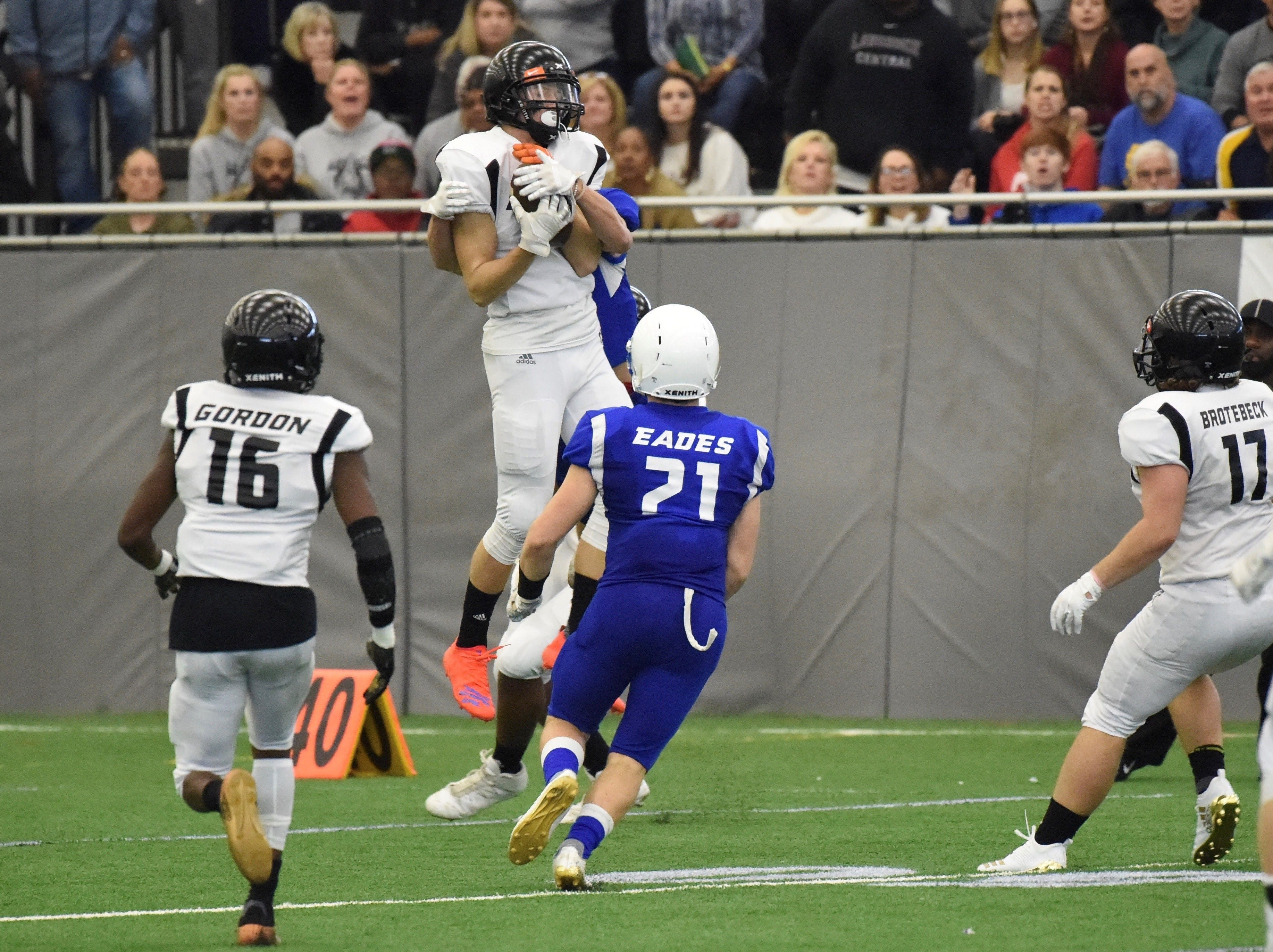 Brighton's Jack Krause jumps up to secure an interception for Team Legends in the final minutes of Sunday's all-star game at Legacy Center Sports Complex. Closing in on Krause is Team Legacy's Nathan Eades (Howell). Also shown are Carte'yae Gordon (Lansing Sexton) and Ryder Brotebeck (Grand Blanc).