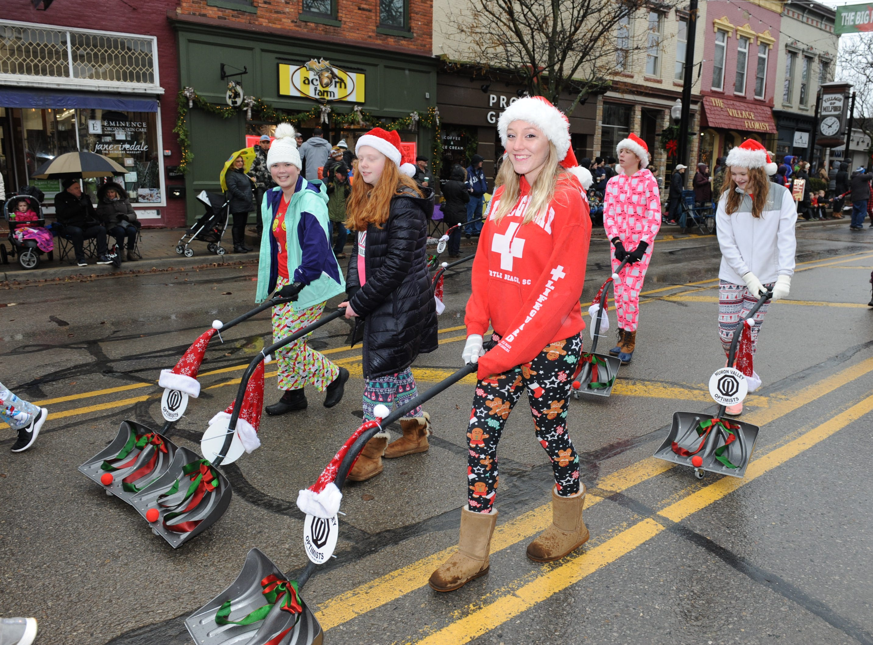 Ladies from the Huron Valley Optimists were ready for the snow as they marched in the Christmas parade in Milford.