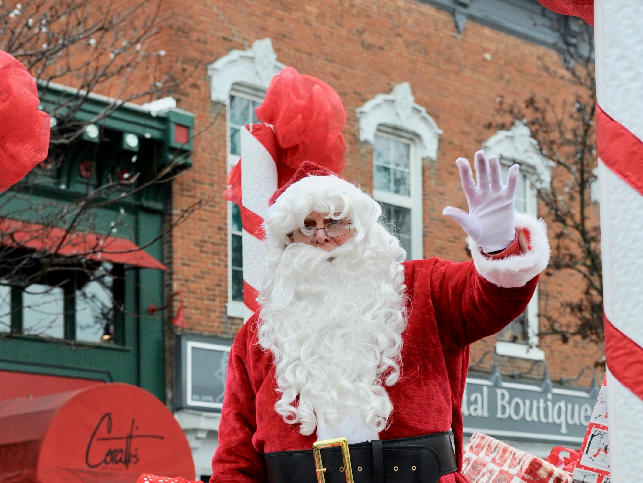 Santa arrives Saturday morning in downtown Milford.