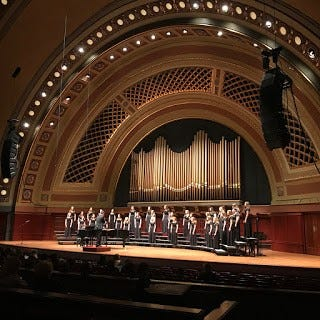 The varsity women's choir performing during the U-M Women's Glee Club fall concert inside Hill Auditorium.
