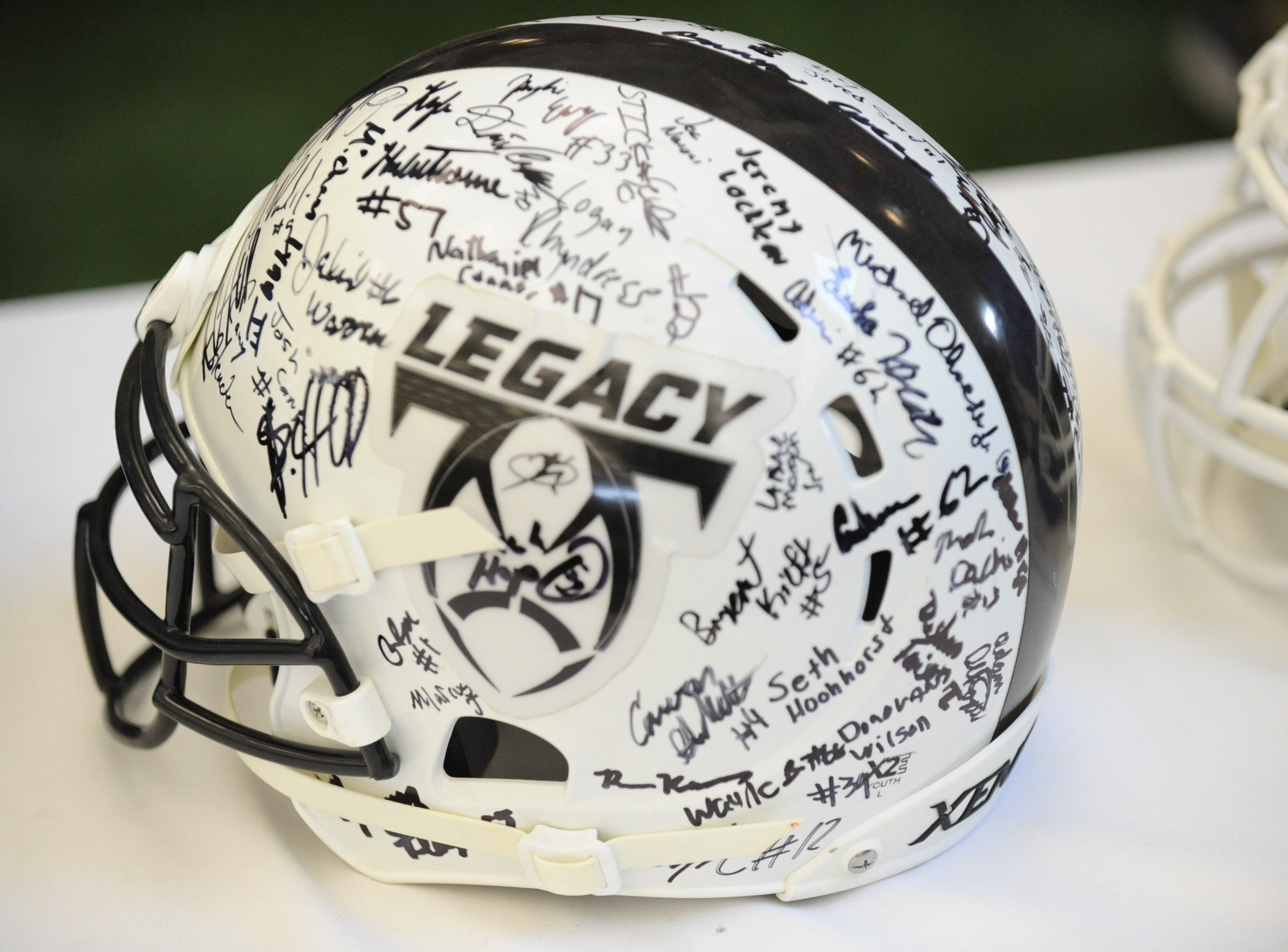 An autographed Legacy football helmet was on display.