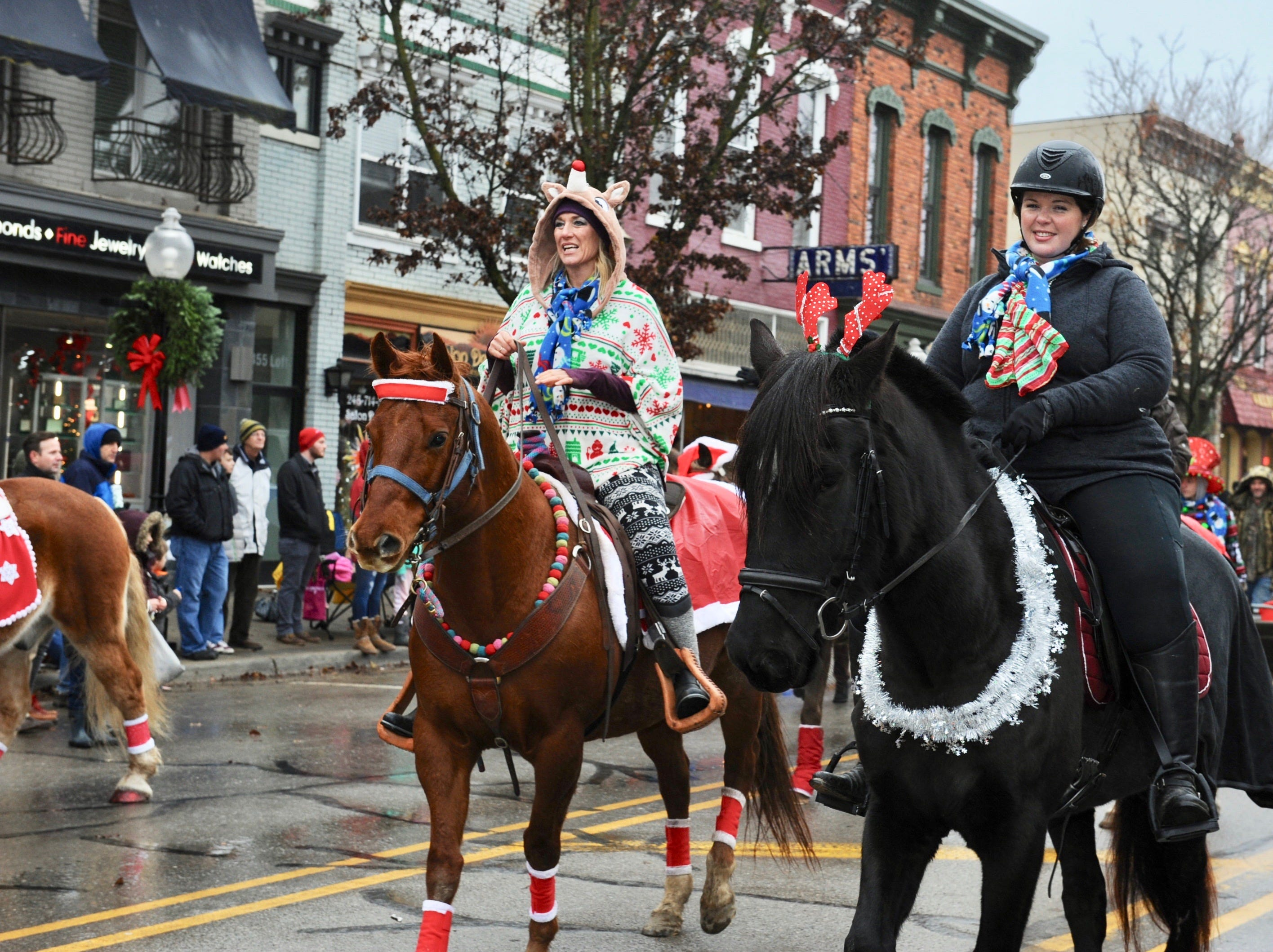 The White Lake, Milford, Highland and Holly Equestrians show off beautiful horses at this year's parade.