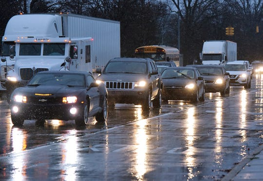 The westbound I-96 service drive has heavy traffic as vehicles are forced to exit the freeway at Farmington Road.