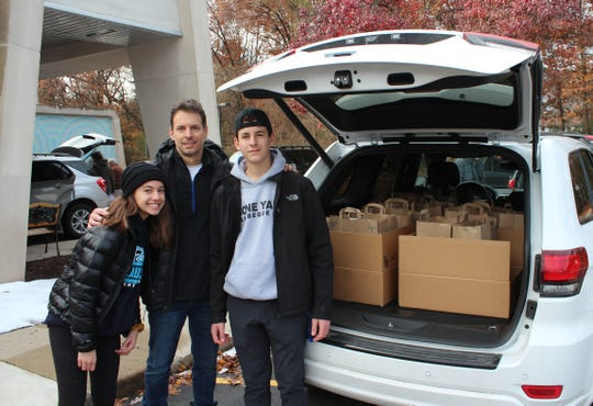 George Pascaris and his family helped deliver Thanksgiving food to needy families in Westland and Livonia.