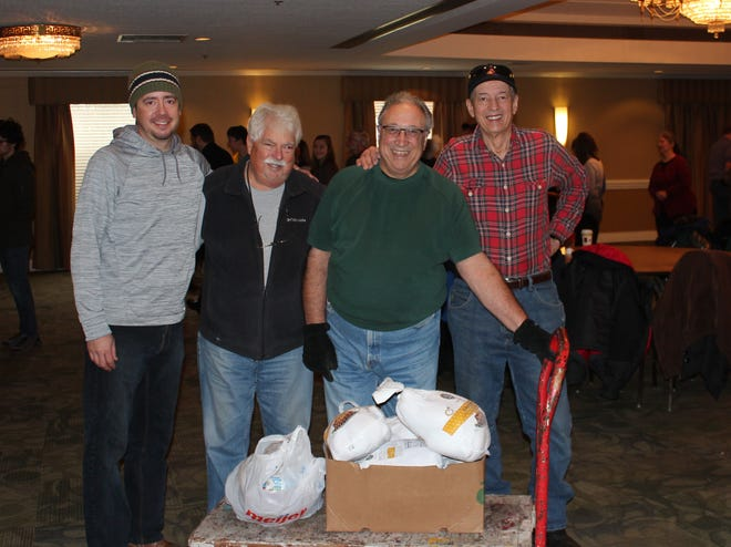 Sts. Constantine and Helen Greek Orthodox Church parishioners David Sudia (left), Jeff Zeh, Strat Calagias and Al Sudia organizing the annual food drive.