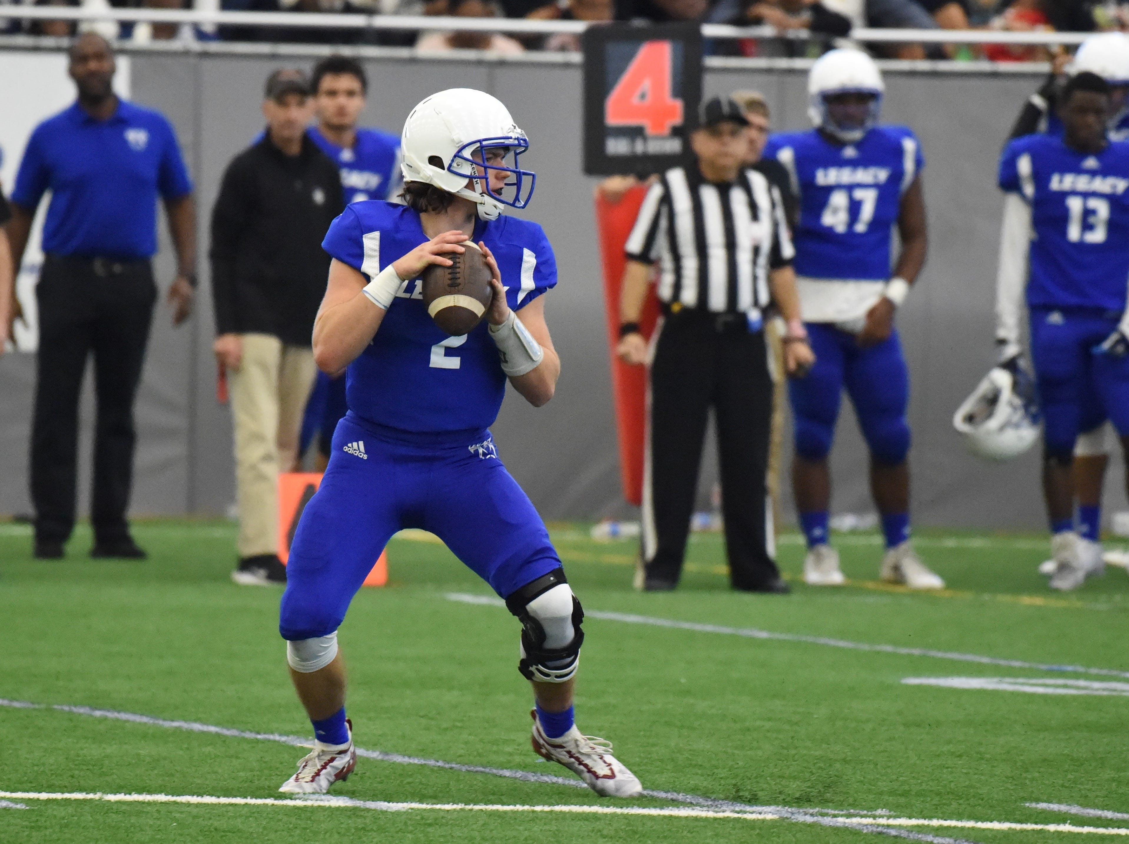 Back to launch a pass for Team Legacy is quarterback Gray Kinnie (2), from Birmingham Seaholm.