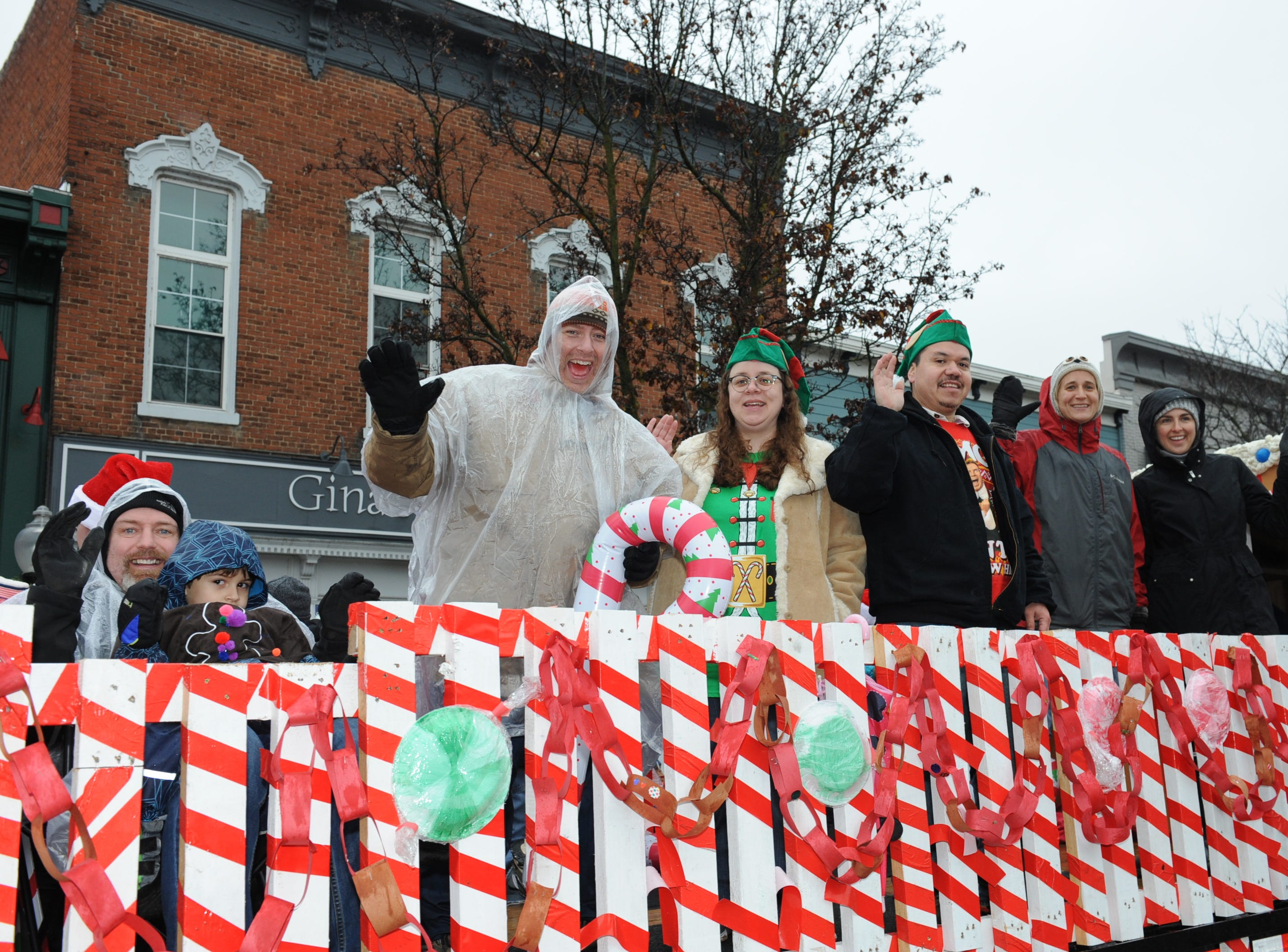 Milford Cooperative Preschool members wave to the crowds during the annual parade held on Saturday.