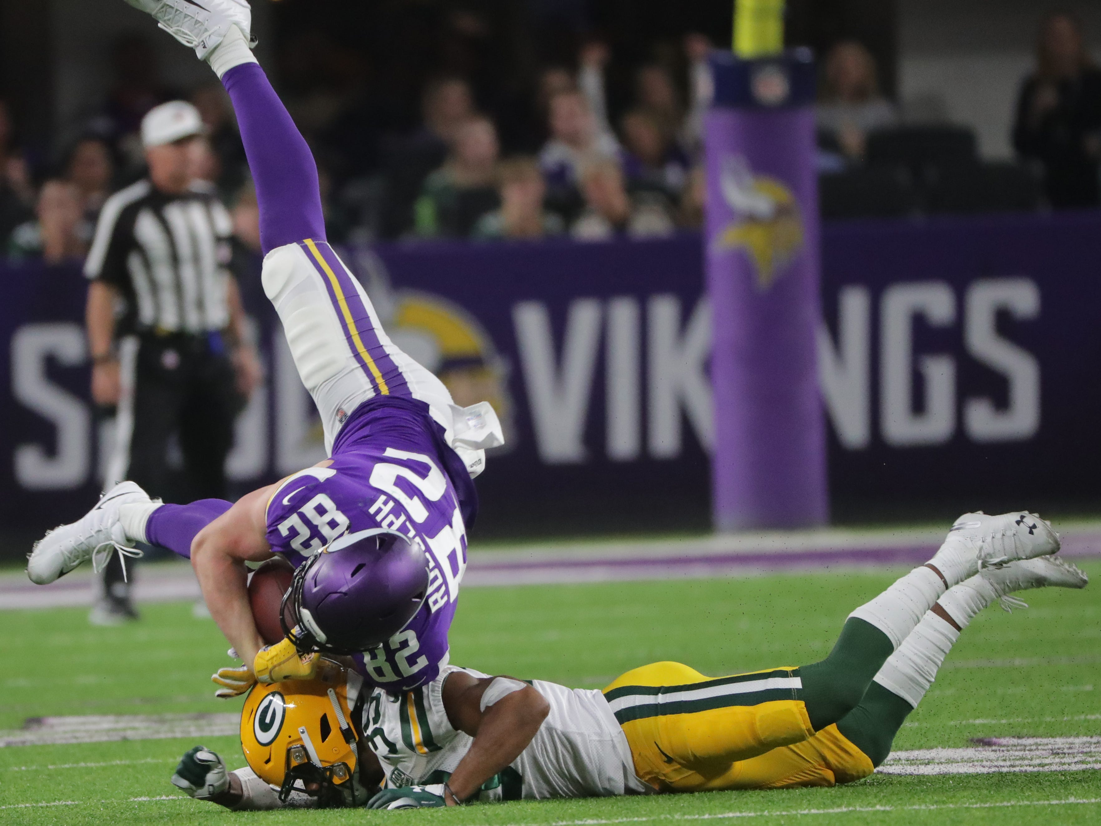 Minnesota Vikings tight end Kyle Rudolph (82) is upended by by Green Bay Packers defensive back Ibraheim Campbell (39) during the3 second  quarter of their game against the Minnesota Vikings Sunday, November 25, 2018 at U.S. Bank Stadium in Minneapolis, Minn.