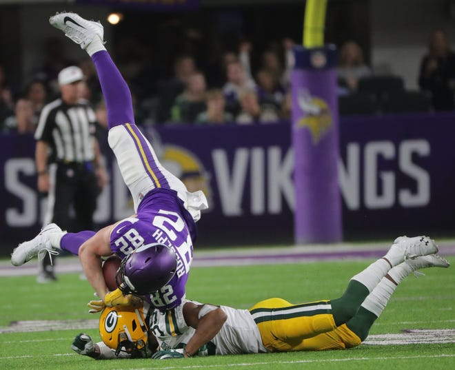 Minnesota Vikings tight end Kyle Rudolph (82) is upended by by Green Bay Packers defensive back Ibraheim Campbell (39) during the3 second  quarter of their game against the Minnesota Vikings Sunday, November 25, 2018 at U.S. Bank Stadium in Minneapolis, Minn.MARK HOFFMAN/MHOFFMAN@JOURNALSENTINEL.COM